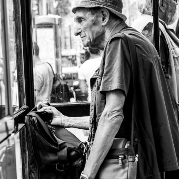 Street Photography Old man standing at a bus stop in London