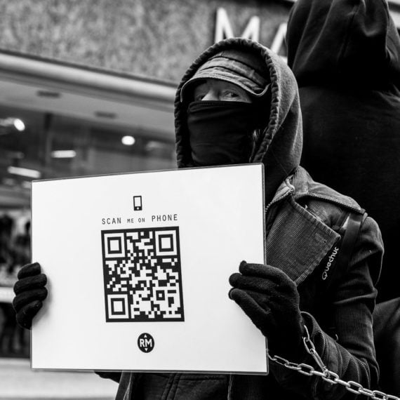 Street photography Demonstrator holding up a sign in Sheffield
