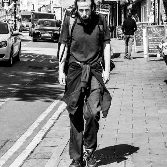 Street photography Man walking street in Bristol