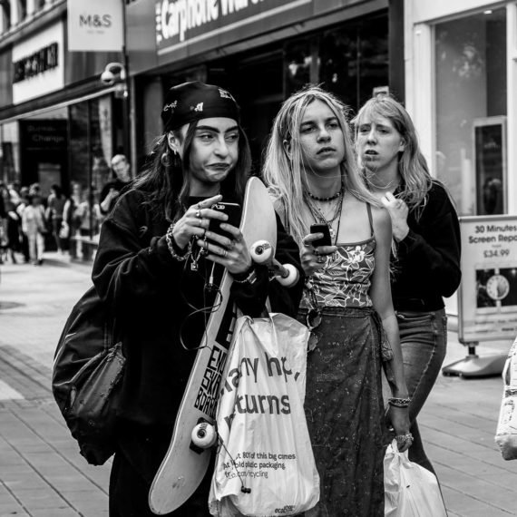 Street Photography Girl pulling a face at another girl